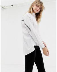 ONLY – Oversize-Hemd mit Seitenstreifen - Weiß