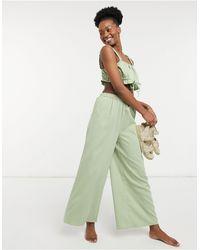 Fashion Union Esclusiva - Pantaloni da mare a vita alta con fondo ampio, colore verde prato