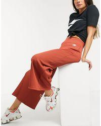 Nike – Gerippte Jogginghose mit weitem Bein und hohem Bund - Orange