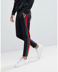 Criminal Damage Skinny Logo Sweatpants In Black