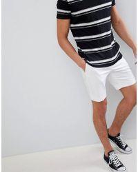 ASOS Pantaloncini slim eleganti lunghezza media in rasatello di cotone bianchi - Bianco