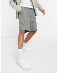 The North Face Shorts verdes antidesgarros