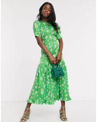 Never Fully Dressed Vestito lungo a maniche corte a balze verde a fiori con fondo a volant