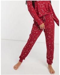 Chelsea Peers Pigiama lungo con stelle laminate - Rosso