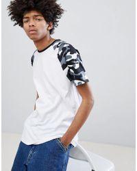 Bershka - Raglan T-shirt With Camo Sleeves In White - Lyst