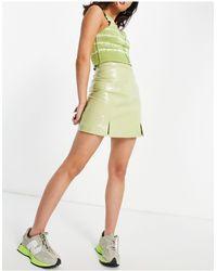Muubaa Mini-jupe en cuir fendue sur le devant - verni - Multicolore