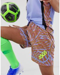 ASOS 4505 Football Short With Dolphin Hem In Animal Print - Blue