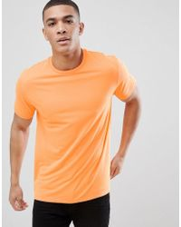 ASOS DESIGN - Relaxed Fit T-shirt In Neon Orange - Lyst