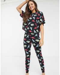 ASOS ASOS DESIGN Curve - Ensemble pyjama avec legging et t-shirt en jersey à imprimé dinosaure fluo - Noir