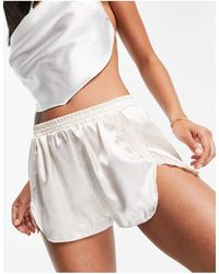 Lost Ink Shorts color champán - Blanco