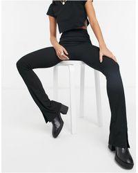 TOPSHOP Pantaloni a zampa con spacco sul davanti, colore nero