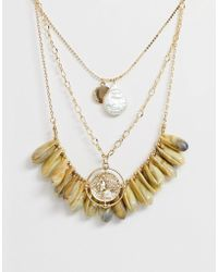 ASOS - Multirow Necklace With Faux Shells And Vintage Style Cut Out Coin Pendant In Gold Tone - Lyst