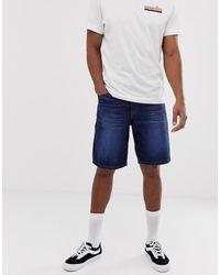 ASOS Short patineur en jean - délavé foncé - Bleu