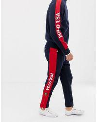Polo Ralph Lauren - Pantalon de survêtement à ourlet zippé avec bande à logo sur le côté - Bleu marine/rouge - Lyst