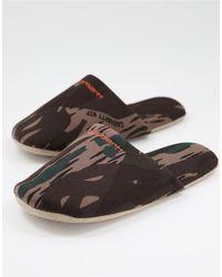 Carhartt WIP Chaussons à inscription brodée - camouflage - Multicolore