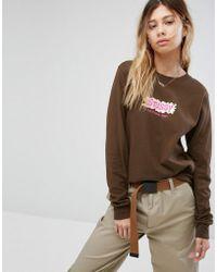 Stussy Camiseta de manga larga con grfico de logo lquido de - Marrón