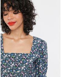 & Other Stories Blusa con mangas abullonadas y estampado floral llamativo multicolor - Azul