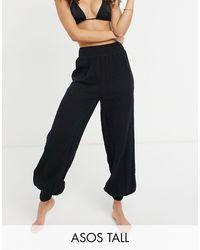 ASOS Pantalones playeros negros con efecto arrugado
