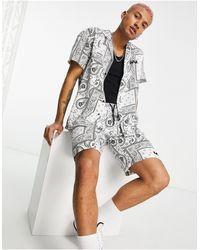 Mennace Camisa blanca estilo bowling con estampado - Blanco