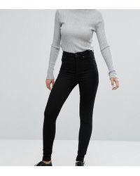 Monki - Oki - Enge Jeans mit hoher Taille und Bio-Baumwolle in Tiefschwarz - Lyst