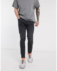 Bershka Skinny Jeans With Knee Rips And Abrasions - Black