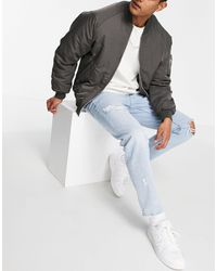 ASOS - Jeans affusolati anni '90 lavaggio chiaro con strappi - Lyst