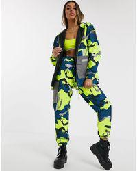 Nicce London Veste oversize d'ensemble avec poches réfléchissantes et imprimé camouflage coloré - Vert
