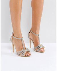 7eb68f1a6db Gold Glitter Bow Heeled Sandals - Metallic