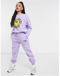 ASOS Hourglass Tracksuit Oversized Sweat / Oversized jogger With Happy Face Graphic - Purple