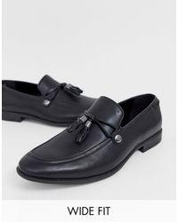 ASOS – Loafer aus schwarzem Kunstleder mit Quastendetail, weite Passform