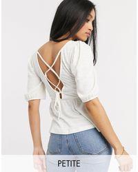 Vero Moda - Top peplo bianco con laccetti sul retro - Lyst