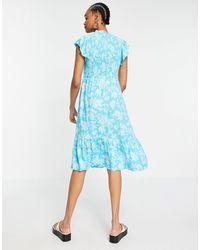 Y.A.S - Синее Платье Миди С Высоким Воротом, Расклешенными Рукавами И Цветочным Принтом -многоцветный - Lyst