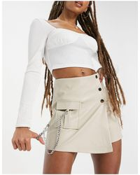 The Couture Club Asymmetric Buckle Detail Mini Skirt - White