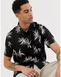Bellfield Camisa negra de viscosa con estampado Paradise - Negro