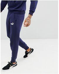 PUMA – Essential – Schmale Jogginghose - Blau