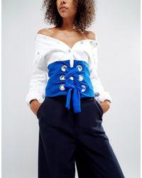 ASOS ASOS - Ceinture corset aux couleurs vives avec gros œillets - Bleu