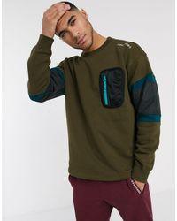 Converse – Mountain Club – Khaki Sweatshirt mit Rundhalsausschnitt und aufgesetzter Tasche - Grün