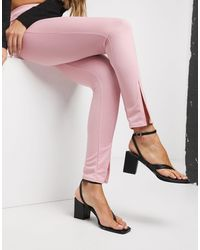 Fashionkilla Pantaloni slim con spacco rosa