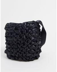 Weekday – Amina – Tasche mit gehäkelter Schleife - Schwarz