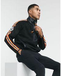 Superdry – Mountain – Sweatshirt aus Polarfleece mit kurzem Reißverschluss - Schwarz