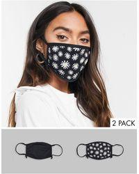 Skinnydip London Esclusiva - Confezione da 2 mascherine con laccetti regolabili nero tinta unita e con margherite
