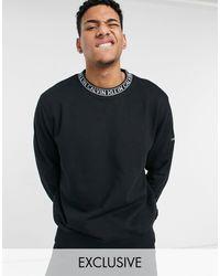 Calvin Klein In esclusiva per ASOS - - Felpa comoda nero CK con logo sul collo