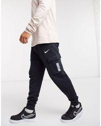 Nike On Tour Pack - Joggers cargo neri con fondo elasticizzato e logo - Nero