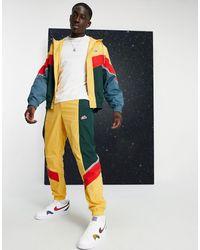 Nike Джоггеры С Манжетами Горчичного Цвета Из Тканого Материала Heritage Essentials Windrunner-желтый - Многоцветный