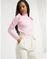 River Island Jersey rosa claro con adorno