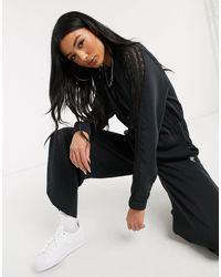 adidas Originals Bellista - Combinaison avec empiècements en dentelle - Noir