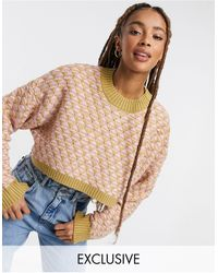 Reclaimed (vintage) – Inspired – Pullover mit Rautenmuster - Pink