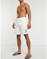 Calvin Klein – e Strandshorts aus Jersey - Weiß