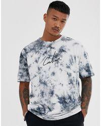 Camiseta negra con logo en el pecho de The Couture Club asos Jeans