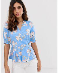 Vero Moda – Gestreifte und geblümte Freizeitbluse mit Knopfdetails - Blau
